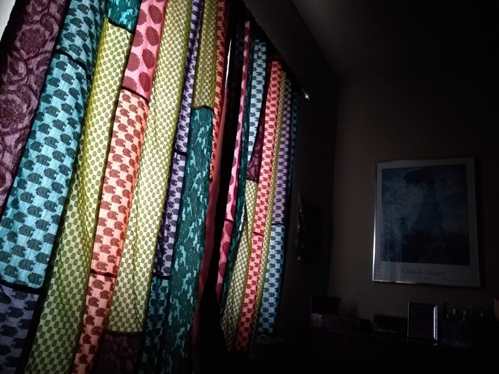 Morning light through quilt-like curtains.
