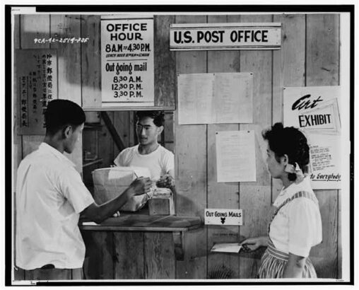 Japanese Americans using postal service at Puyallup Assembly Center for letters and packages.
